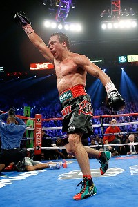 AP Photo/Eric JamisonJuan Manuel Marquez celebrates after knocking Manny Pacquiao out in the sixth round. Pacquiao was ahead 47-46 on all three scorecards following the fifth.